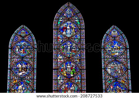 DUBLIN, IRELAND - JUNE 28, 2014: Three stained glass windows in St. Patrick's Cathedral, depicting different biblical scenes. The windows were made by the English firm of William Wailes & Co. - stock photo
