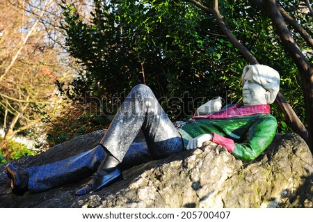DUBLIN, IRELAND - MARCH 30, 2013: Statue of the famous writer Oscar Wilde in Merrion Square, Dublin, Ireland - stock photo