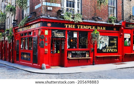 DUBLIN, IRELAND - MARCH 30, 2013: Temple Bar is a famous landmark in Dublins cultural quarter visited by thousands of tourists every year. - stock photo