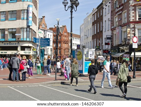 DUBLIN, IRELAND - MAY 25: the junction of Grafton Street and St. Stephen's Green on May 25, 2013 in Dublin, Ireland. Grafton Street is one of two main shopping streets in Dublin.  - stock photo