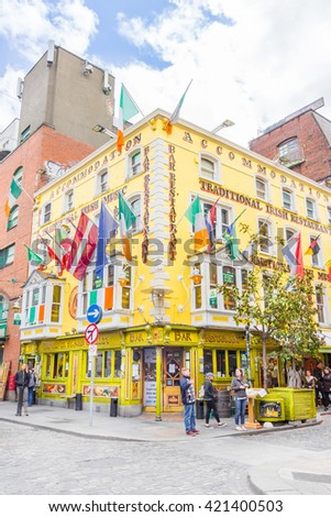 DUBLIN, IRELAND - 05 MAY, 2016: Tourists walking in the Temple Bar area. The place is the cultural quarter in the center of the city and is full of restaurants, bars and nightclubs. - stock photo