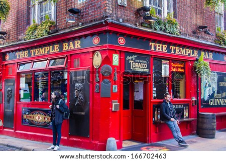 DUBLIN, IRELAND - NOV 11: Street scene in Dublin, Ireland on November 11, 2013. Temple Bar historic district is known as Dublins cultural quarter with lively nightlife. - stock photo