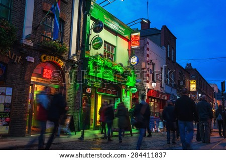 DUBLIN, IRELAND - NOVEMBER 11, 2014: Nightlife at popular historical part of the city - Temple Bar quarter. The area is the location of many bars, pubs and restaurants - stock photo