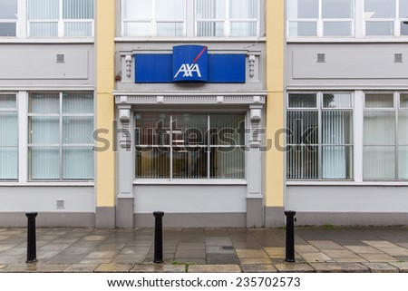 DUBLIN, IRELAND - OCTOBER 3, 2014: AXA insurance offices. Axa is present in 56 countries, has 157,000 employees and distributors and 102 million clients. It had revenue Euro 91,249 million in 2013. - stock photo