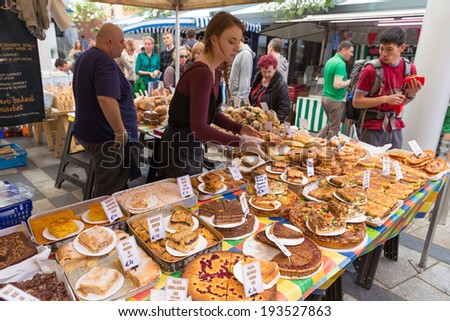 DUBLIN - MAY 17, 2014: Temple Bar Food Market is located at Meeting House Square. This weekly market takes place every Saturday in Dublins city centre. - stock photo