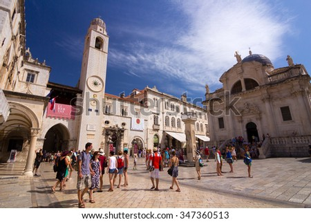 Dubrovnik, Croatia-August 24, 20214: A group of tourists in front of St. Blaise Church (Crkva sv. Vlaha) and belfry in old town of Dubrovnik, Croatia - stock photo