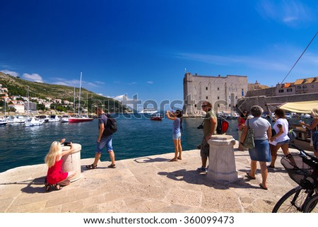 Dubrovnik, Croatia-August 24, 2014: A group of tourists in Old Port, Dubrovnik, Croatia - stock photo