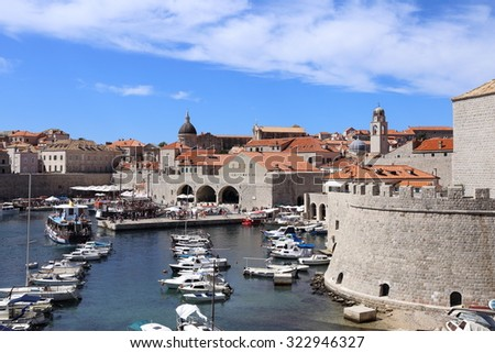 DUBROVNIK, CROATIA - AUGUST 23 2015. The harbour at Dubrovnik is bustling and busy with tourists on AUGUST 23 2015. - stock photo