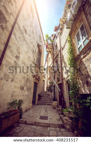 DUBROVNIK, CROATIA - MAY 03, 2015: Scene of the main street and other narrow streets, with locals and tourists, in Dubrovnik, Croatia - stock photo