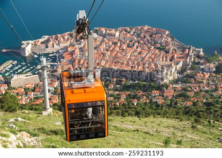 DUBROVNIK, CROATIA - MAY 26, 2014: Tourists at Cable car which connects Ploce and  mountain Srdj above town where you can enjoy a panoramic view of Old Town and the surrounding islands. - stock photo