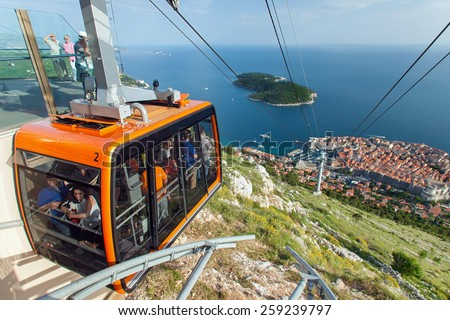 DUBROVNIK, CROATIA - MAY 26, 2014: Tourists in the Dubrovnik cable car. It connects Ploce and  mountain Srdj above town where you can enjoy a panoramic view of Old Town and the surrounding islands. - stock photo