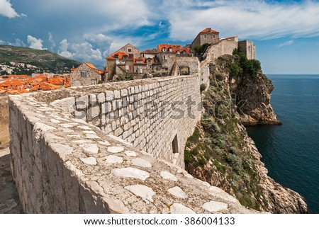 Dubrovnik, Croatia view from city walls overlooking walls and sea with cliffs during the day - stock photo