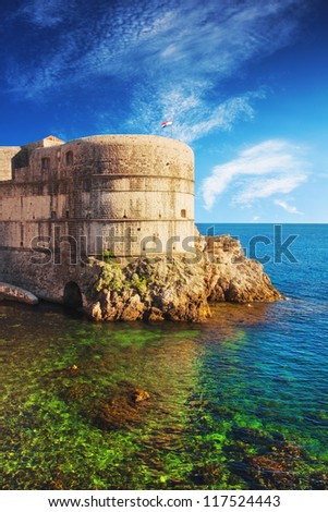 Dubrovnik old city walls at sunset - stock photo