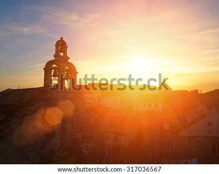 Dubrovnik walls, bell tower and sunset, Croatia, Balkan Peninsula, Europe - stock photo