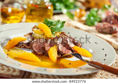 Duck Breast with Orange and Potato. Garnished with Orange Sauce and Parsley - stock photo