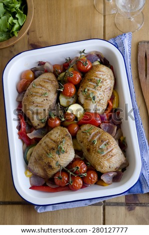 Duck breasts with roasted vegetables - stock photo
