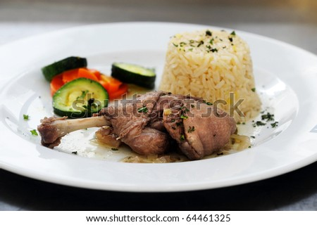 Duck casserole served with rice and vegetables - stock photo