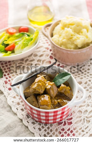 Duck filet in tomato gravy with vanilla served with mashed potatoes - stock photo