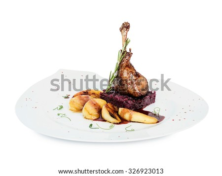 duck leg cooked with apples on a plate - stock photo