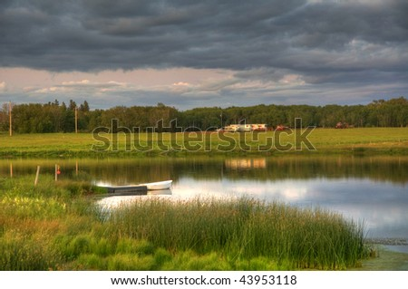 duck pond with cottage in the background - stock photo