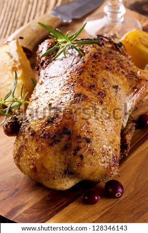 duck roasted on the wooden board - stock photo