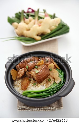 Duck with rice and vegetables in background - stock photo
