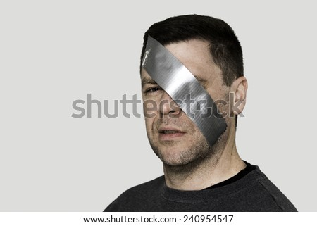 Duct Tape Over Eye - stock photo