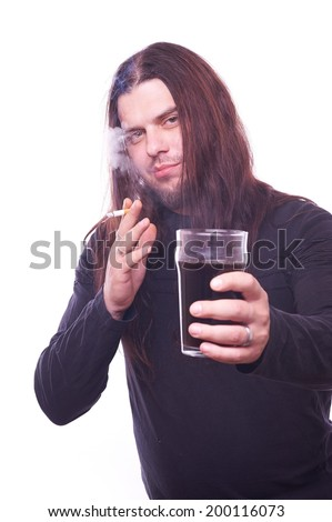 Dude with flowing hair holding beer glass and smoking, studio shot - stock photo