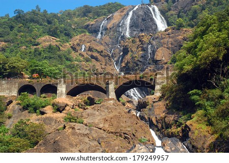 Dudhsagar waterfall and railroad bridge in Goa/India - stock photo
