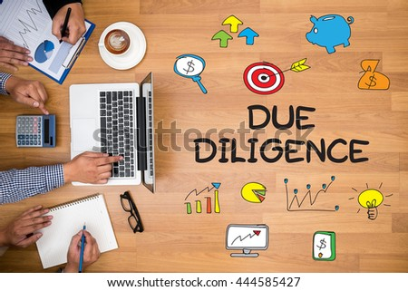 due diligence  Business team hands at work with financial reports and a laptop - stock photo