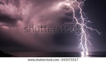 Duel bolts strike at sea - stock photo