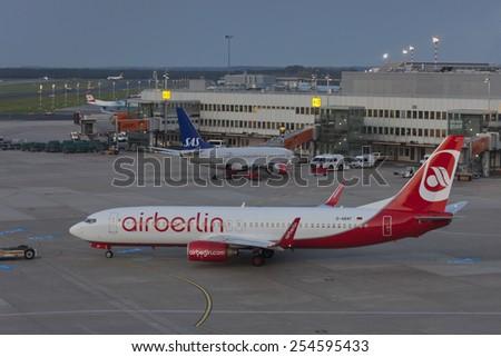 DUESSELDORF, GERMANY - SEPTEMBER 25, 2011: Boeing 737 of Air Berlin rolling to runway on International Airport in Duesseldorf, Germany.  - stock photo