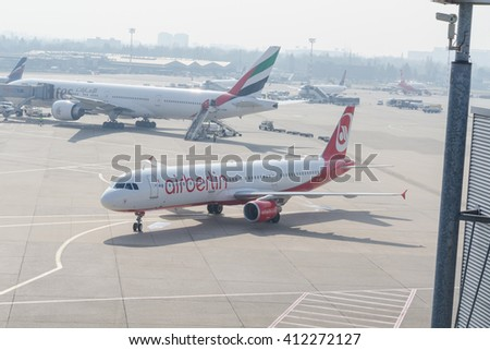 DUESSELDORF, NRW, GERMANY - MARCH 18, 2015:Up, Airplane Dusseldorf. View of the tarmac. Large passenger airplane at the gate. - stock photo