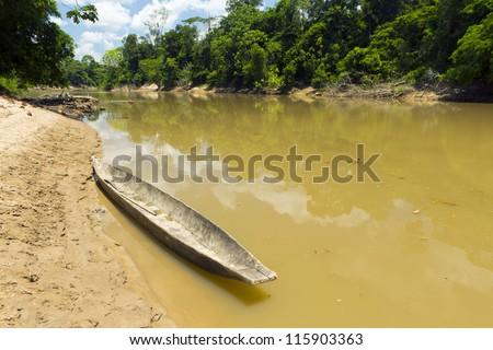 Dugout canoe beside the Rio Cononaco in the Ecuadorian Amazon - stock photo