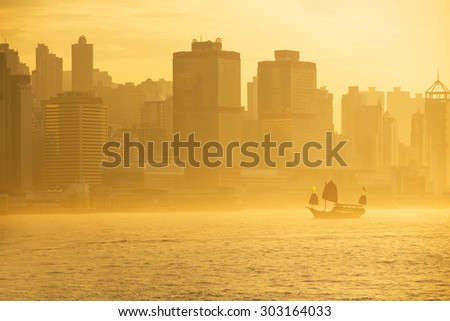 Duk Ling Ride at sunset, Traditional wooden sailboat sailing in victoria harbour, Hong Kong - stock photo