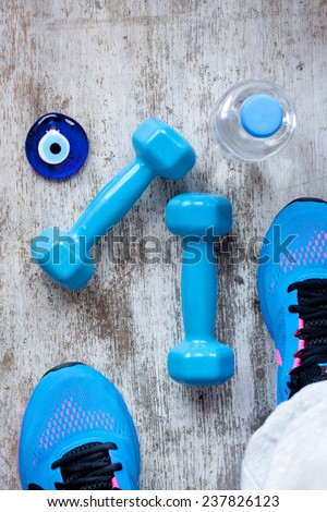 dumbbell and sport shoes - stock photo