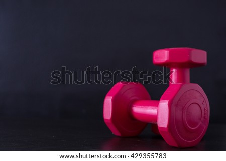 Dumbbell for building your body with black background. - stock photo