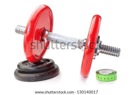 Dumbbell on disk and tape measure meter. For fitness. Slimming. - stock photo