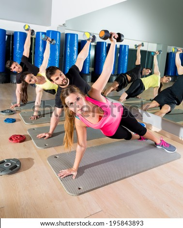 Dumbbell push up group functional training circuit at fitness gym - stock photo