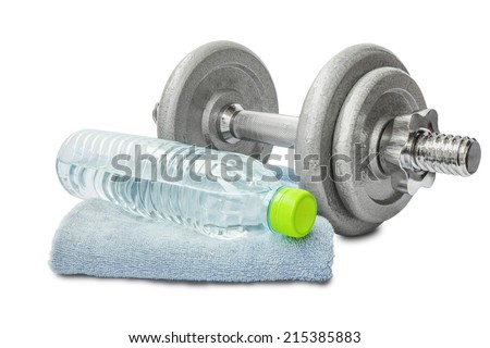 dumbbell with water bottle and towel for using in the gym - stock photo