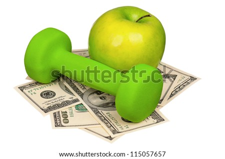 Dumbbells with apple on heap of dollars isolated on a white background - stock photo