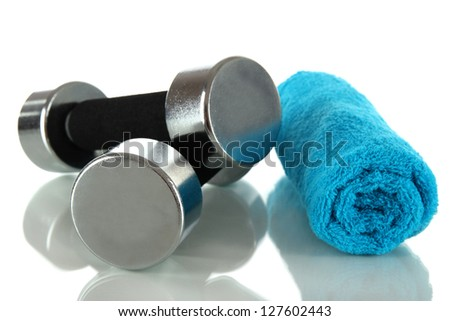Dumbbells with towel isolated on white - stock photo