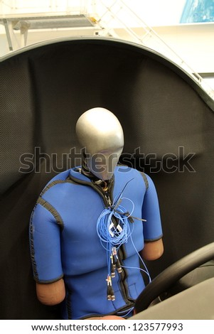 Dummy sits in the chair ready for test - stock photo