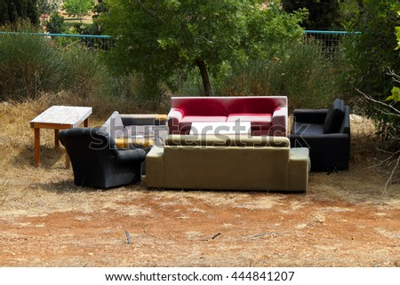 dump furniture that young people adapted for parties - stock photo