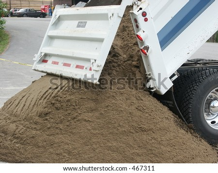 Dump Truck dropping load - stock photo