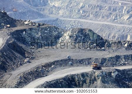 Dump truck in the asbestos quarry - stock photo
