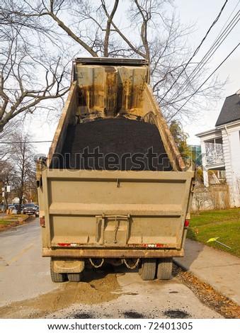 Dump truck loaded with asphalt - stock photo