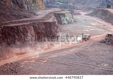 dumper truck driving along in quarry mine pit. - stock photo