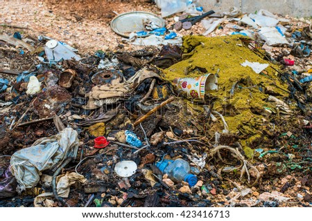 Dumping Trash Outdoors - stock photo