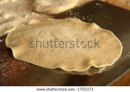 dumpling dough, focus on center, shallow dof - stock photo